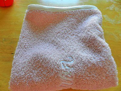 Re-Purpose Worn Bath Towels Into Smaller Hand Towels